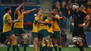SYDNEY, AUSTRALIA - AUGUST 08:  The Wallabies celebrate with Nick White of the Wallabies after he scored a try during The Rugby Championship match between the Australia Wallabies and the New Zealand All Blacks at ANZ Stadium on August 8, 2015 in Sydney, Australia.  (Photo by Mark Kolbe/Getty Images)